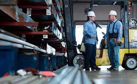 Engineers in industrial warehouse